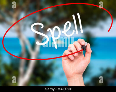 Man Hand writing Spell with black marker on visual screen - Stock Photo