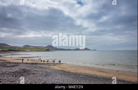 Tourists on the Ballingskelligs Bay Beach - Stock Photo