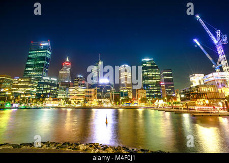 Perth, Australia - Jan 5, 2018: Esplanade with modern skyscrapers and construction cranes reflecting on the Swan - Stock Photo