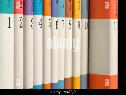 Eleven numbered books in a row - Stock Photo