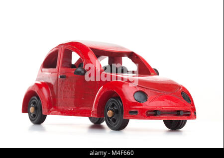 Red retro wooden toy car isolated on white background - Stock Photo
