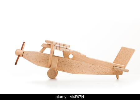 Retro wooden airplane isolated on white background - Stock Photo