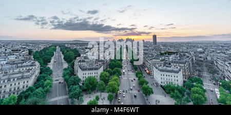 Sunset skyline of Paris with la defense and streets - Stock Photo