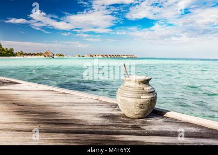 Wooden jetty towards a small island in Maldives - Stock Photo