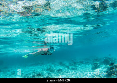 Woman snorkeling underwater in Indian Ocean, Maldives - Stock Photo
