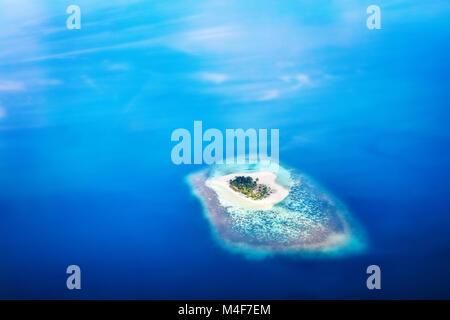 Heart shape island in Maldives, Indian Ocean - Stock Photo