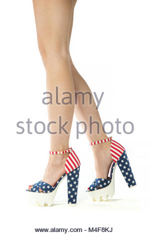 beautiful legs in high heels with stars and stripes - Stock Photo