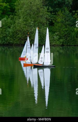Radio controlled racing sailboats. - Stock Photo