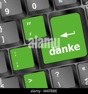 a thank you (danke) message on enter key of keyboard - Stock Photo
