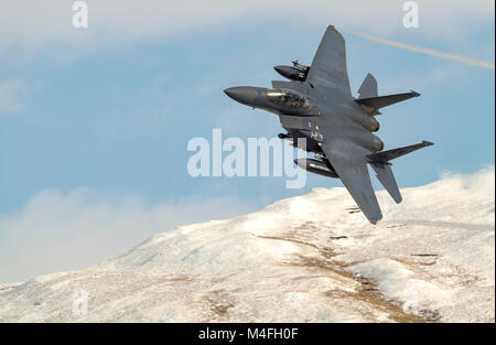 USAF F-15E Strike Eagle from the 48th Fighter Wing low level flying training in Wales - Stock Photo