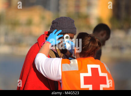 Malaga, Malaga, Spain. 16th Feb, 2018. A member of Spanish Red Cross uses a thermometer to check the temperature - Stock Photo