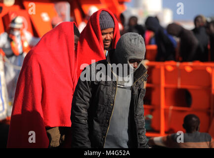 Malaga, Malaga, Spain. 16th Feb, 2018. Migrants are seen disembarking at Malaga Port.Arrival of a group of migrants - Stock Photo
