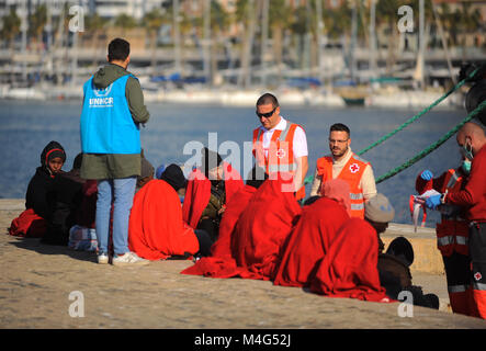 Malaga, Malaga, Spain. 16th Feb, 2018. A group of migrants are assisted by member of Spanish Red Cross as they landed - Stock Photo