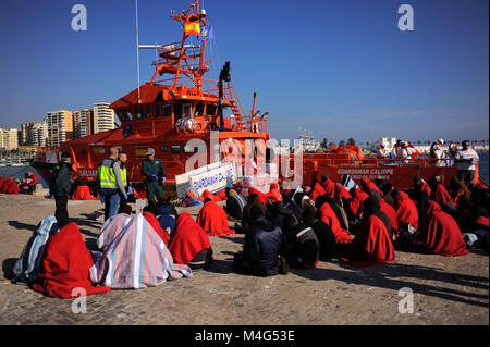 Malaga, Malaga, Spain. 16th Feb, 2018. A general view of a migrants in the port after their disembarkation. Arrival - Stock Photo