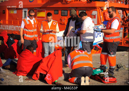 Malaga, Malaga, Spain. 16th Feb, 2018. A migrant is assisted by member of Spanish Red Cross. Arrival of a group - Stock Photo