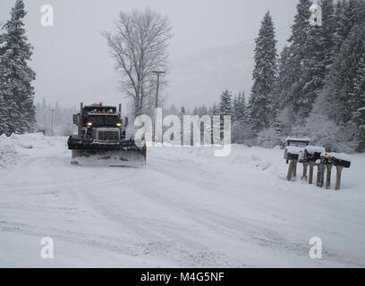Snow event. Snow storm. A tandem axle Peterbuilt snow plow truck plowing the snow and sanding the road on the South - Stock Photo
