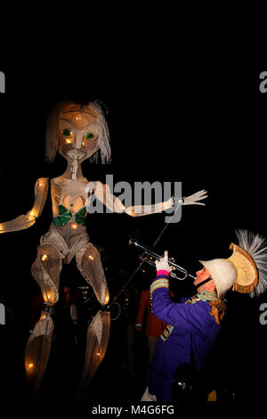 Oldham, UK. 16th Feb, 2018. A trumpet player and giant sized puppet at illuminate Oldham, 16th February, 2018 (C)Barbara - Stock Photo