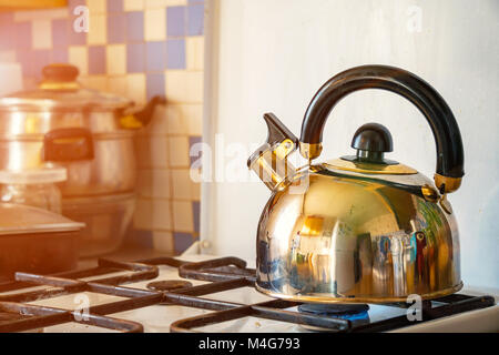 The whistling kettle on a gas stove - Stock Photo