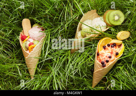 Berry ice cream in waffle cone - Stock Photo