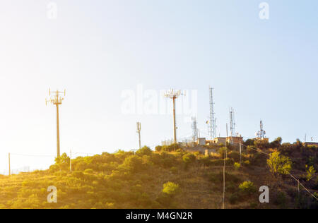 Antennas on the top of the hill - Stock Photo