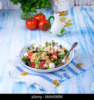 Mediterranean Farfalle salad with dry tomatoes and pine cores - Stock Photo