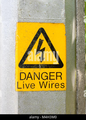 yellow electrical lamp post warning sign - Stock Photo