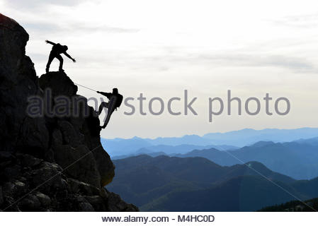 climbers the help,support and interest - Stock Photo