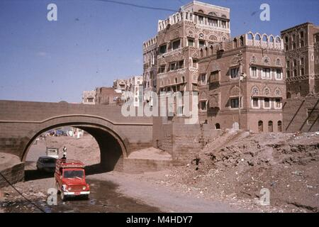 Cars use a wadi (dried out river bed) as a main road in Sanaa. - Stock Photo