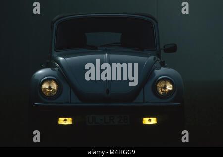 A VW Beetle Convertible at dusk. - Stock Photo