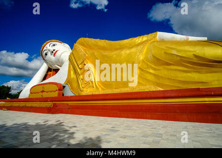 The 101 meters long Reclining Buddha statue is located in Maha Bodhi Ta Htaung near Khatakan Taung village - Stock Photo
