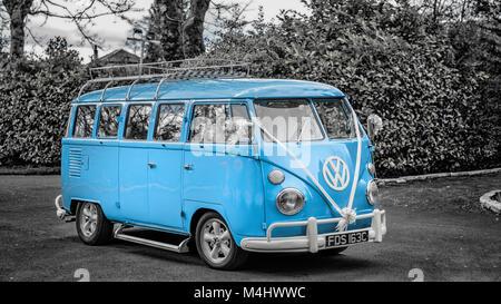 Fully restored blue Volkswagen Split Screen camper van brought back to life to provide unique wedding transport - Stock Photo