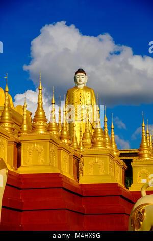 Details and sculptures of the golden Aung Sakkya Pagoda, located below Laykyun Sekkya Buddha in Maha Bodhi Ta Htaung - Stock Photo