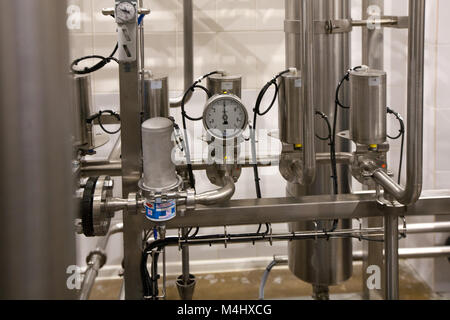 Pressure gauge (manometer) of white metal -  brewing equipment. Close-up, macro. - Stock Photo