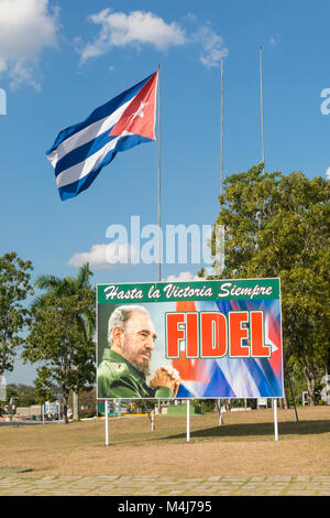 SANTA CLARA, CUBA: Poster with image of Fidel Castro and Cuban flag in the Revolution square in the city of Santa - Stock Photo