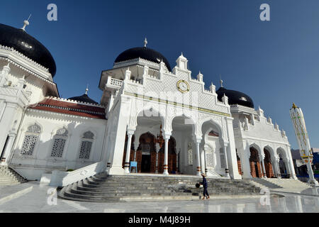 Baiturrahman Grand Mosque with cloud and blue sky view located in Banda Aceh, Capital city of Aceh-Indonesia. - Stock Photo