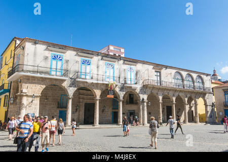 HAVANA, CUBA: Tourists at the Cathedral Square on a beautiful day. Old Havana, Cuba. In this square is the cathedral, - Stock Photo