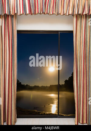 window view of the full moon - Stock Photo