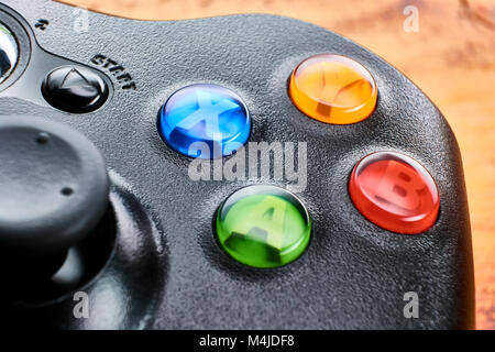 BUENOS AIRES, ARGENTINA - FEBRUARY 16, 2018: Closeup of an XBOX 360 gamepad on table. - Stock Photo