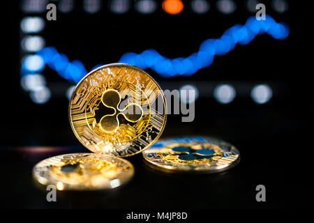 Ripple XRP crypto currency showing bullish signs on market with chart going up - Stock Photo