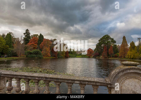 The House and Ten Foot Pond, from the Garden Bridge, Sheffield Park, Uckfield, East Sussex, England - Stock Photo