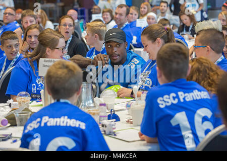 Detroit, Michigan - Detroit Lions linebacker Tahir Whitehead talks with students during a physical activity and - Stock Photo