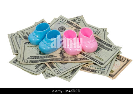 Ahorizontal shot of a  blue and pink baby booty sits on a pile of twenty and ten dollar bills on a white background. - Stock Photo