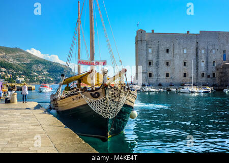 A tour boat similar to a pirate ship docks in the Dubrovnik Harbour, Croatia on the Dalmatian Coast of the Adriatic - Stock Photo