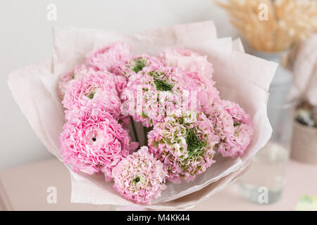 Persian buttercup. lace with many petals. Bunch pale pink ranunculus flowers light background. Wallpaper
