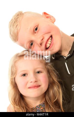 brother and sister, laughing and having fun, happy childhood - Stock Photo