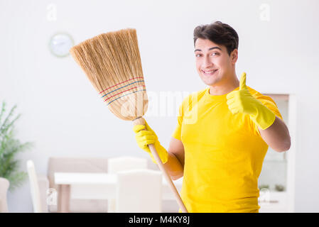 Young man doing chores at home - Stock Photo