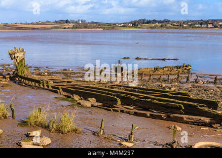 Bits of old boats visible at low tide on the Exe Estuary, Devon. - Stock Photo