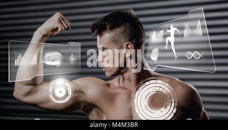 Athletic fit man flexing muscles in gym with health interface - Stock Photo