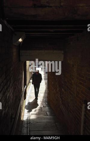 Figure in dark alley way,UK. - Stock Photo