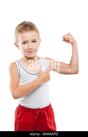 Smiling sport child boy showing hand biceps muscles strength - Stock Photo